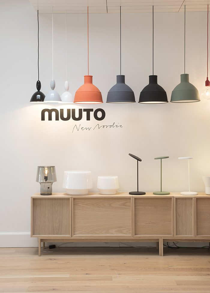 The space marries usability with refined presentation. Here, an assortment of Mhy, Unfold, and E27 pendant lamps (left to right) hang above Cosy lamps by Harri Koskinen (left) and Leaf lamps by Broberg & Ridderstråle (right).  Photo 4 of 7 in Muuto's Sophisticated Copenhagen Office is All About Transparency