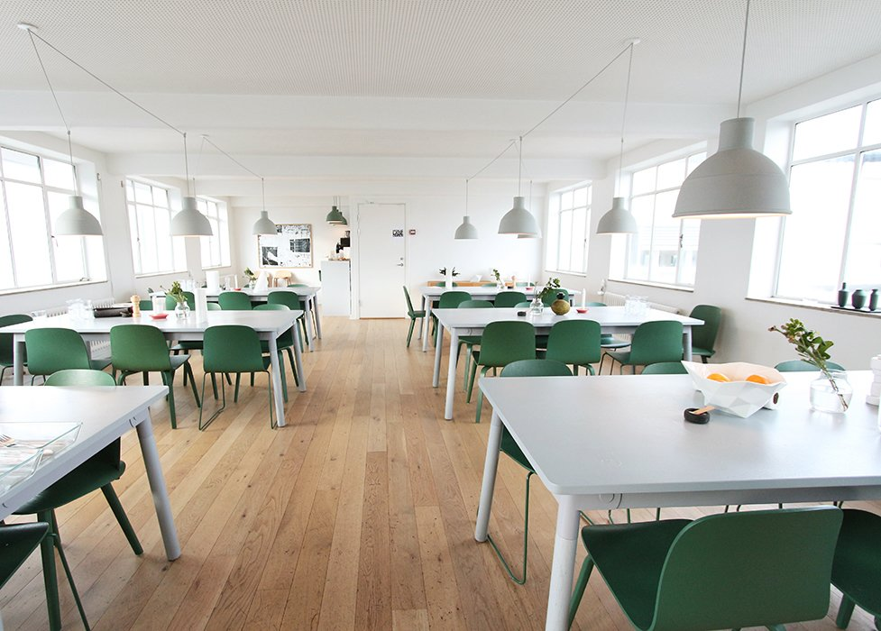 The interior design team avoided the temptation to use too many bright colors. The canteen, for example, features three different versions of the NERD chair in Muuto green, even though it is available in eight different colors.  Photo 5 of 7 in Muuto's Sophisticated Copenhagen Office is All About Transparency