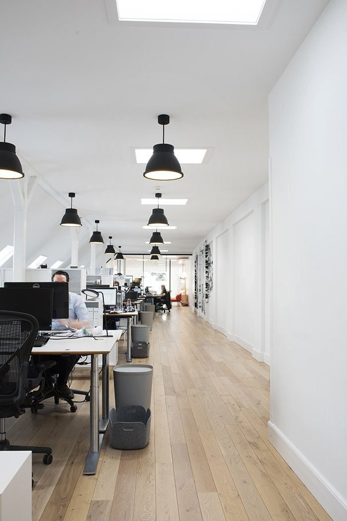 """Brandt explains the decision to allow guests to glimpse Muuto's inner workings: """"You can see that we are concentrated and producing. It reassures you that we deliver good solutions and come up with a great combination of products.""""  Photo 7 of 7 in Muuto's Sophisticated Copenhagen Office is All About Transparency"""