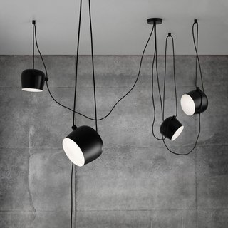 Designed by vanguards Ronan and Erwan Bouroullec for FLOS, the Aim LED Light reinvigorates the pendant light. Opting to highlight the cable cord instead of hiding it, the substantial cable becomes a central design element. This interesting feature allows the cable to be looped, gathered, crossed or draped adding sculptural intrigue to an innovative design.