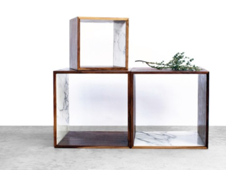 The interior of 2131's Walnut and Marble Storage Cube is lined with Italian Calacatta Gold. The cubes can be stacked or used individually.