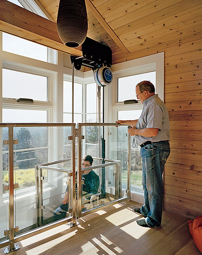 """Shed & Studio and Sun Room Room Type A custom-designed chairlift system from Versicor allows Matthew access to the tower. """"The new house has really liberated Matthew. My goal is that he will have access to everything by one means or another,"""" says Ed Slattery.  Photo 6 of 8 in This Impressively Accessible Home Has a Tower That Can Be Reached by Wheelchair"""