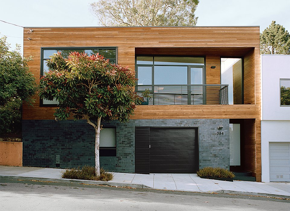 Exterior, House Building Type, Brick Siding Material, and Wood Siding Material Bernstein reconfigured the entryway to the street level; guests ascend to the main living space. Ironspot clay tile and FSC-certified cedar clads the facade.  Photo 2 of 13 in A Meticulous Renovation Turns a Run-Down House Into a Storage-Smart Gem