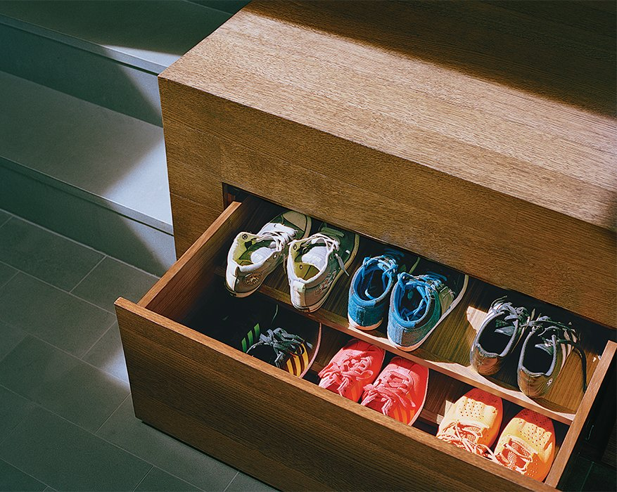 Storage Room and Cabinet Storage Type Generous storage is key to an uncluttered look. Drawers for shoes tuck away under the raised mezzanine floor.  Photo 10 of 13 in A Meticulous Renovation Turns a Run-Down House Into a Storage-Smart Gem