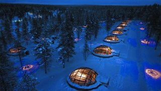 Kakslauttanen (Saarriselka, Finland)  True, these glass-covered igloos are built for two, but as far as small dwellings go, there are few that can boast such commanding views of the Northern Lights. So remote that it has a section on its website to reassure potential guests that it does, in fact, get phone service, the glass rooms looks like a grid of dots (or perhaps umlauts) against the snow-covered wilderness.   Photo by Kakslauttanen