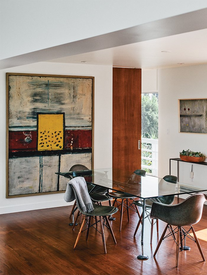 Dining Room, Table, Recessed Lighting, Ceiling Lighting, Chair, and Medium Hardwood Floor In the dining room, artworks by Alan Davie (at left) and Martin Bradley join a Norman Foster dining table.  Photo 14 of 15 in A Midcentury Home Enjoys Views from Every Angle