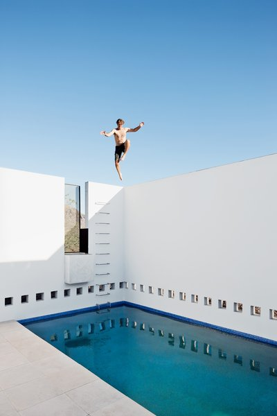 The pool feels as laterally finite as the house feels spacious—but the view goes up forever.
