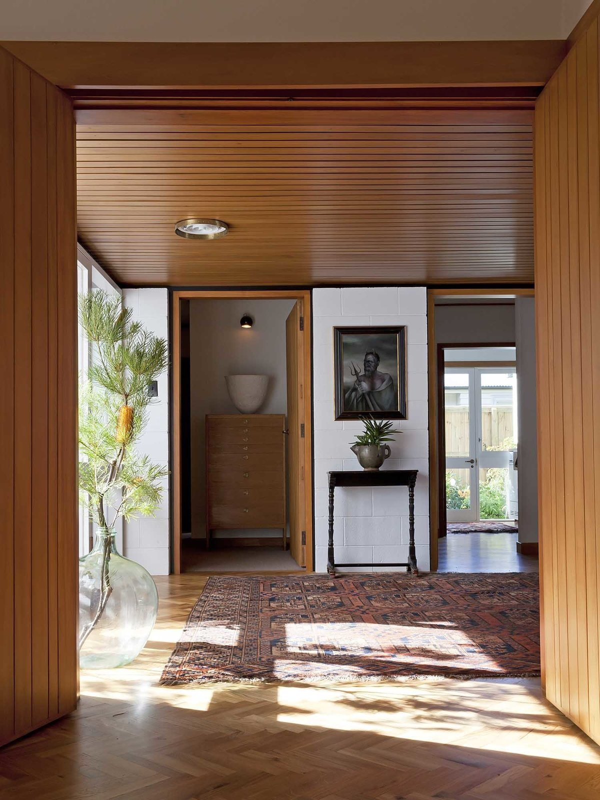 """Hallway and Medium Hardwood Floor Ballantyne House by Warren & Mahoney (1959)  Search """"entryway"""" from Decades Old, the Modernist Houses of New Zealand Have No Shortage of Charm"""