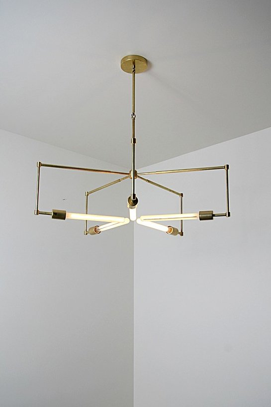 Lines of unfinished hand polished brass and exposed bulbs make up the 'Asterix'.  Lighting from Brass Lighting by Raymond Barberousse
