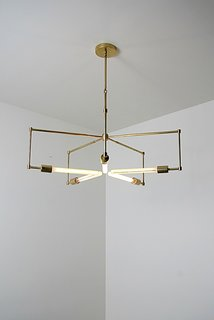 Lines of unfinished hand polished brass and exposed bulbs make up the 'Asterix'.
