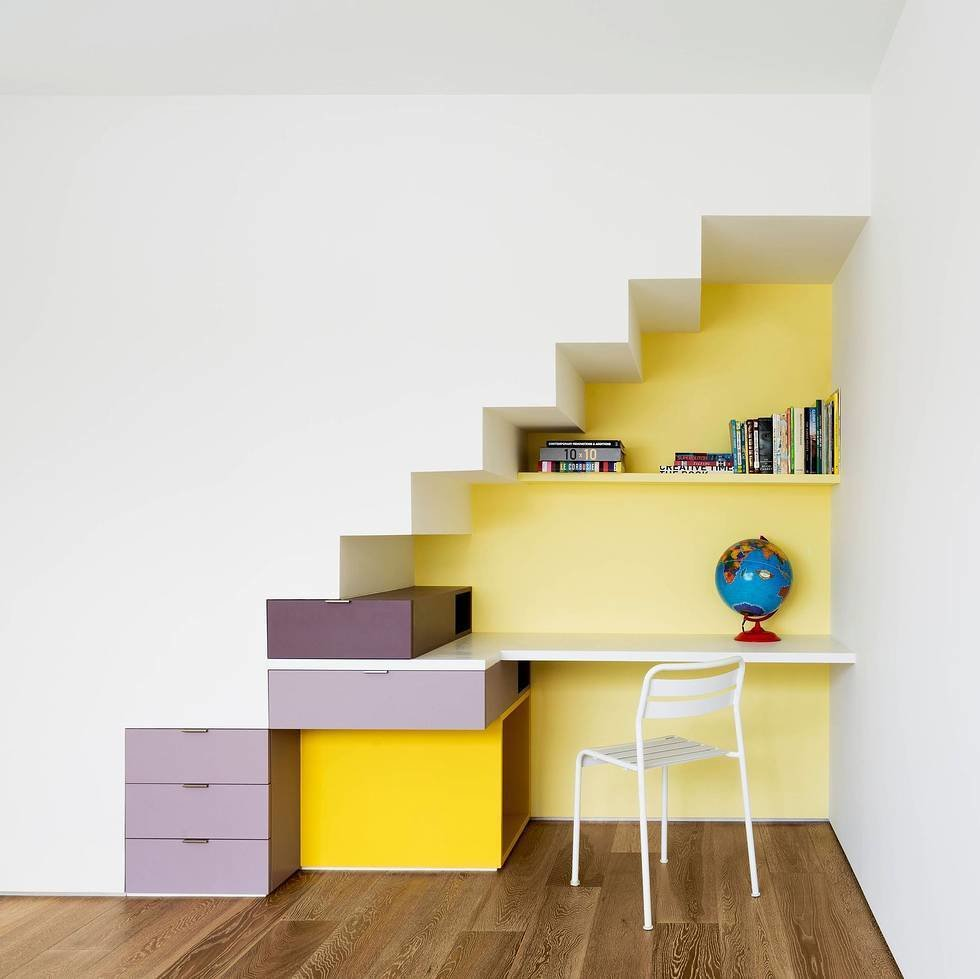 Office, Medium Hardwood Floor, Chair, Desk, and Storage Bright yellow and purple paints were used to add some vibrancy to the daughter's desk area, one of the ways the architects tried to honor the personality of each inhabitant's space.  Inspiratie nieuw huis from Three Unique Homes Fit Under One Roof for an Extended Family in Queens