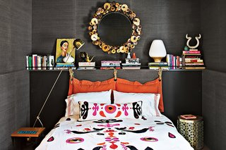 Wallpaper doesn't have to be patterned: for his own Shelter Island home, designer Jonathan Adler lined the walls of the guest bedroom with grasscloth in Slate for a cozy, natural touch.