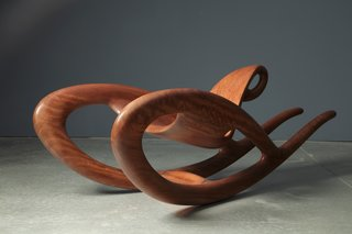 Designer Wendell Castle's work teeters on the line of functional and sculptural. Ghost Rider. Bubinga wood with oil finish. 2010. Courtesy of the artist; Friedman Benda, New York; Photo: Jon Lam Photography.