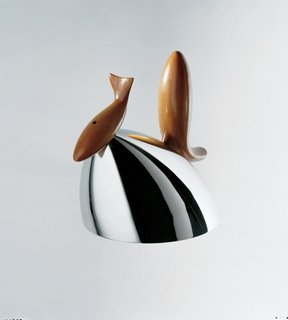Architect Frank Gehry's signature fish appears here in the form of sculptural mahogany on Pito, a tea kettle for Alessi. Stainless steel, mahogany wood. 1992. Courtesy of Museo Alessi; Photo: Aldo Ballo; Photo: Studio Azzurro.