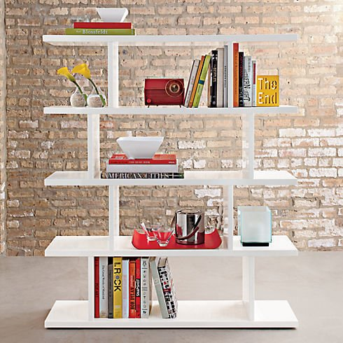 This white hi-gloss lacquered scoreboard bookcase is composed of five staggering shelves, which provides instant architecture to any room. Display solo or gang together for quite the wall.  Room to Shelf  by Jami Smith