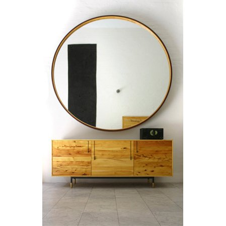 "LEATHER MIRROR  You can really add some drama to a room with the size of this distressed leather framed mirror lined with wood. 72"" diameter."
