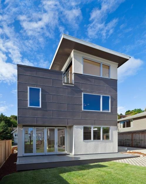 "Exterior, Prefab Building Type, Metal Siding Material, and House Building Type The couple desired a new home that would suit their eco-conscious lifestyle. On their must-have list was a location close to Seattle's recreational-friendly Greenlake, a large roof deck, eco-friendly materials that reduced their carbon footprint, and surprisingly, no garage. ""It is a modular home, so basically you're saving a lot of money on the [construction] time,"" says the team behind Greenfab, which served as general contractor for the project. ""Your construction costs are also way lower.""  Photo 2 of 7 in 7 Prefab Companies That Oregon Dwellers Should Know from Energy-Efficient Prefab Responds to Seattle Climate"