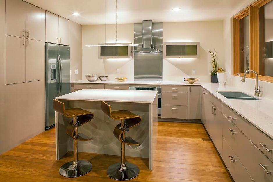 Kitchen, Recessed Lighting, Range Hood, Cooktops, Bamboo Floor, Wall Oven, Refrigerator, White Cabinet, and Undermount Sink If you're seeking an option that is eco-friendly and durable, bamboo flooring is a great choice.
