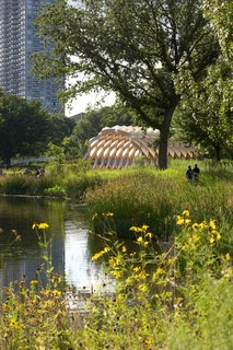 The structure is designed to open up the pond ecosystem to visitors and serve as an outdoor classroom space.