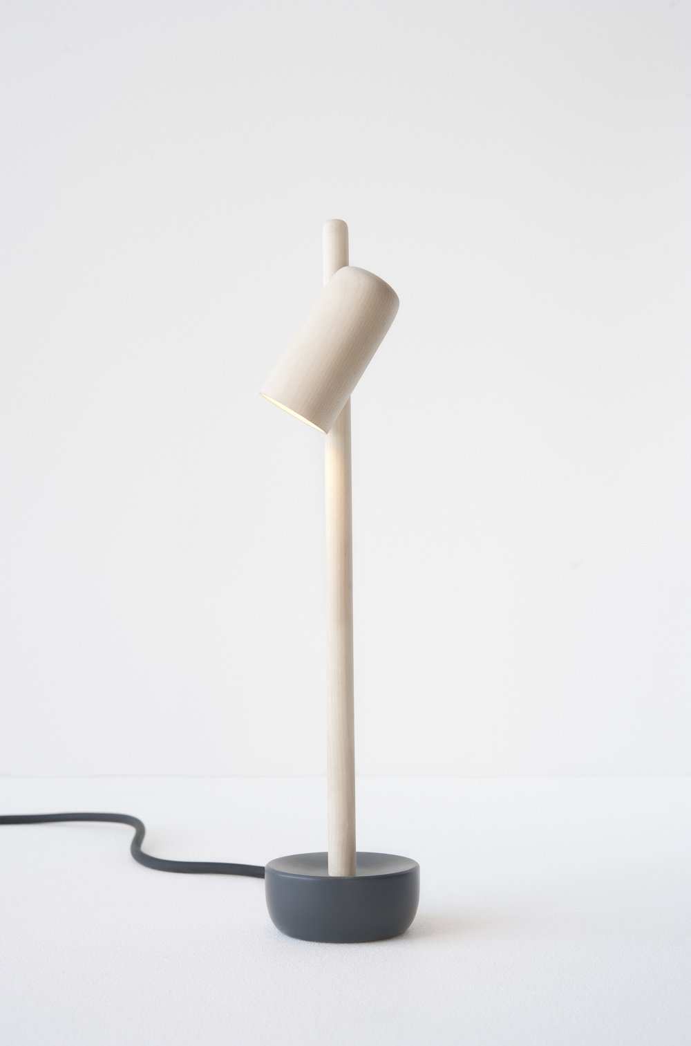 """Riffing on """"the graciously swinging blue bellflower of the mountains of Norway,"""" Andreas Bergsaker's Petiole lamp boasts a shade that can be rotated to direct light wherever one desires. Made of birch, it has an aluminum base.  Photo 7 of 16 in 11 Emerging Talents You Should Know from Salone Satellite 2015"""