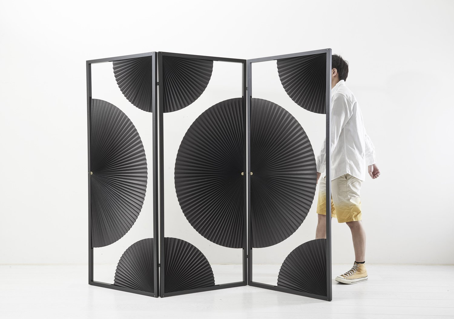 Taiwan studio KiMU Lab marries traditional paper fans with a powder-coated metal frame for its New Old Divider.  Photo 14 of 16 in 11 Emerging Talents You Should Know from Salone Satellite 2015