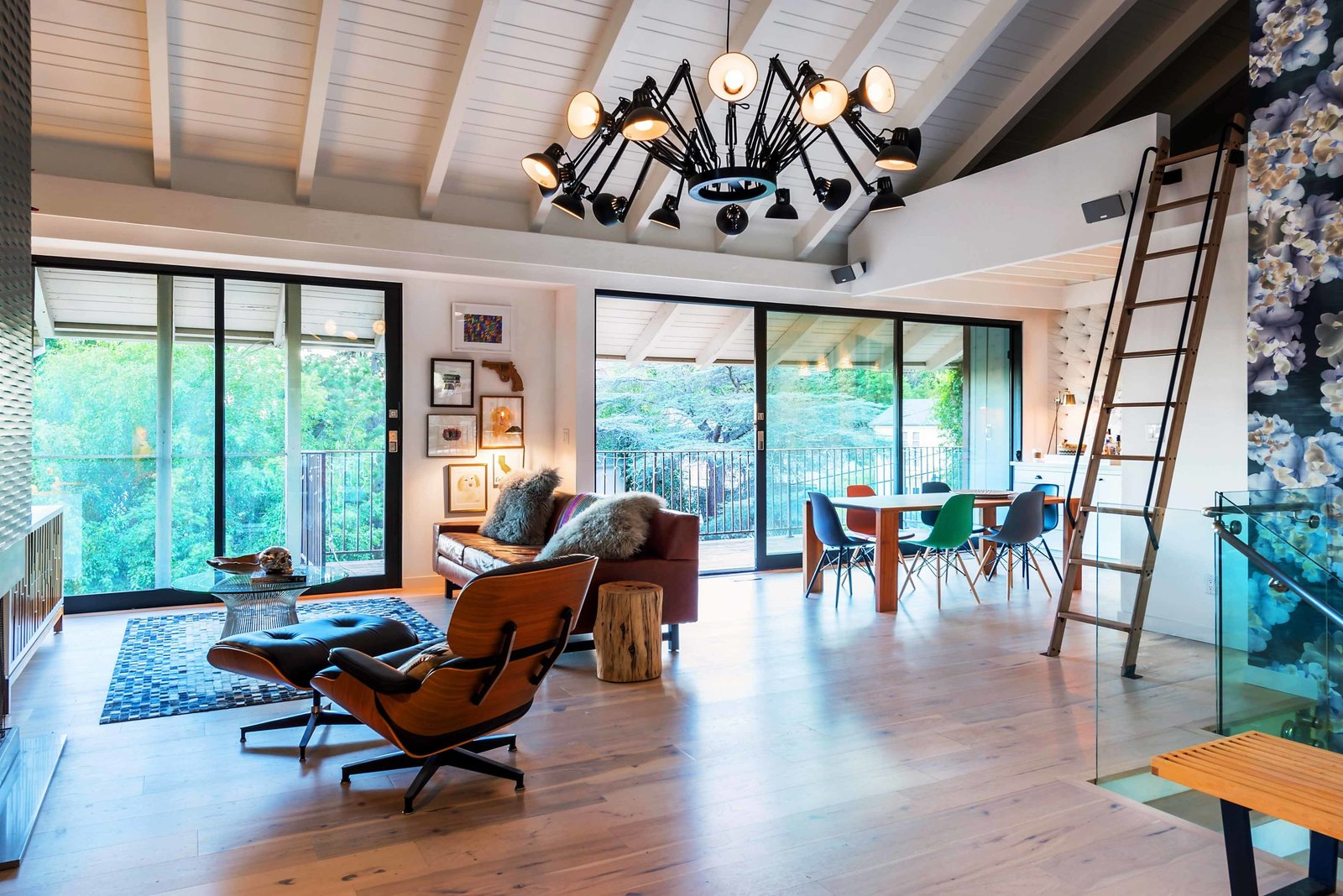 The main level of the two-bedroom house is elegant and contemporary, with whitewash hickory floors and gray and white tones mixed with warm walnut. This way, the designers let the furniture and accent materials produce all the fun.  Photo 1 of 6 in Playful Materials Refresh a Dated Hollywood Home