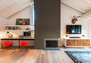 "When JAC Interiors was commissioned to revive an old 1,200-square-foot Hollywood home, the clients—a young couple who the designers call ""fun and quirky""—requested the firm find a way to transform the space with as little construction as possible. The fireplace is a custom-made, three-dimensional feature that stands in stark contrast to the soft woods and white walls that make up the rest of the room."
