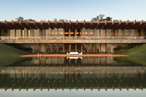 The hotel's façade is a stunning combination of wood, stone, and glass. Downstairs, the restaurant allows guests to enjoy the view of a pristine natural lake as they dine indoors or outdoors.  Photo 3 of 8 in Destination of the Week: São Paulo