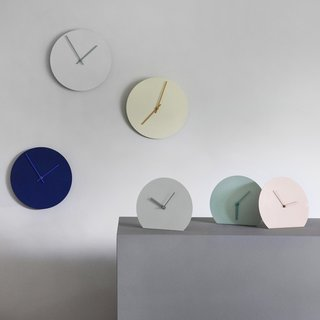 Designed by Norm Architects for Menu, the Steel Table Clock is a celebration of materiality, color, and simplicity. Paring down the clock to its most necessary elements, the designers took the expected silhouette of a wall clock and folded it to create a clock that can rest on a flat surface. The clock is available in four colors, all of which were chosen for their connection to the Scandinavian climate. Powder-coated for a smooth finish, the clock is unobtrusive, and was designed to be an enduring, timeless addition to a home. Also available in a wall clock.