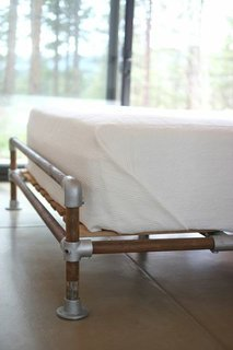 Hirsh and Volny created a bed frame out of a rusted well pipe and scaffolding fittings.