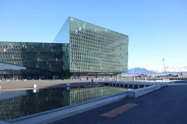 The Harpa Concert Hall and Conference Center was designed by Ólafur Elíasson together with Henning Larsen Architects and Batteríið Architects. It opened in 2011. Photo by: Tiffany Orvet