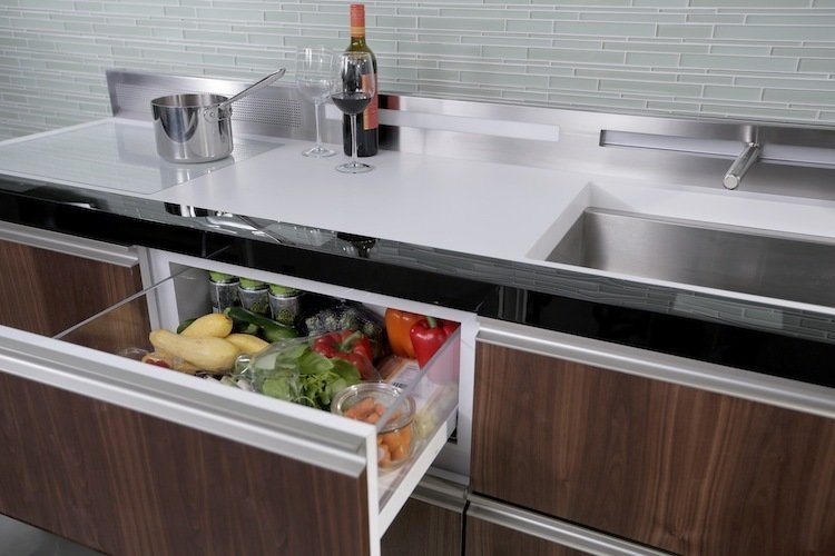 """GE Micro Kitchen Concept  The unit contains 24-inch deep, drawer-based modulesvthat can fit an entire array of appliances (oven, dishwasher, sink, freezer, refrigerator and induction cooktop) within six linear feet.   Image by GE  Search """"7 small spaces incredible kitchens"""""""