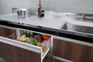 GE Micro Kitchen Concept  The unit contains 24-inch deep, drawer-based modulesvthat can fit an entire array of appliances (oven, dishwasher, sink, freezer, refrigerator and induction cooktop) within six linear feet.   Image by GE