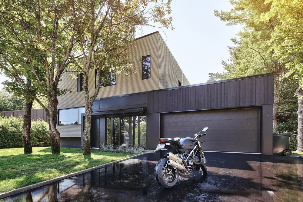 Exterior, House Building Type, and Metal Siding Material The exterior mixes pale gray wood on the vertical volume, and fiber cement and black brick on the horiztonal volume. The three trees in the front yard were maintained during the renovation process.  a