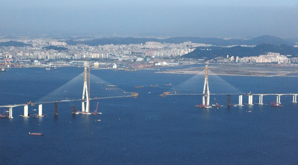 Incheon Bridge, South Korea-Providing new road access to Seoul's Incheon International Airport, the bridge is both long (13 miles) and tall (756 feet). It's shown here before its October 2009 completion. Photo by: Ryan Wick