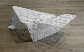 Roman Vlahovic's Lacescape table merges the tradition of Croatian lacemaking, a practice included in UNESCO's Intangible Cultural Heritage list, with digital manufacturing, reinventing a traditional craft through modern processes.