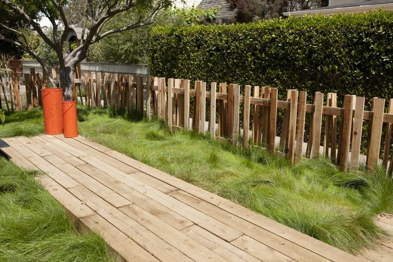 A small fence in the yard echoes the posts that support the new master suite.  30+ Best Modern Fences by William Lamb from Rios Clementi Hale's Nowita Residence
