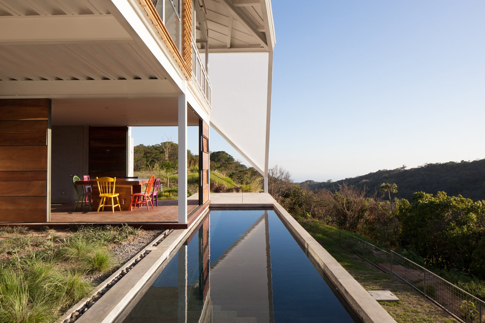 The back patio overlooks a swath of forest.  Photo 4 of 7 in Striking Green House with a View in El Salvador