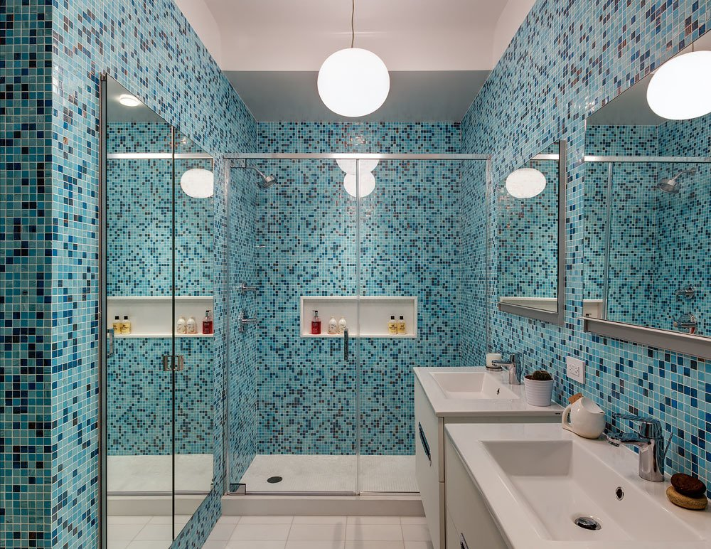 Bath Room and Mosaic Tile Wall Bold color is embraced in the home's first bathroom, with tilework by Trend Mosiacs. Faucets are by Grohe and vanities are by Hastings. A Flos Glo-Ball pendant light illuminates the space.  Bedroom