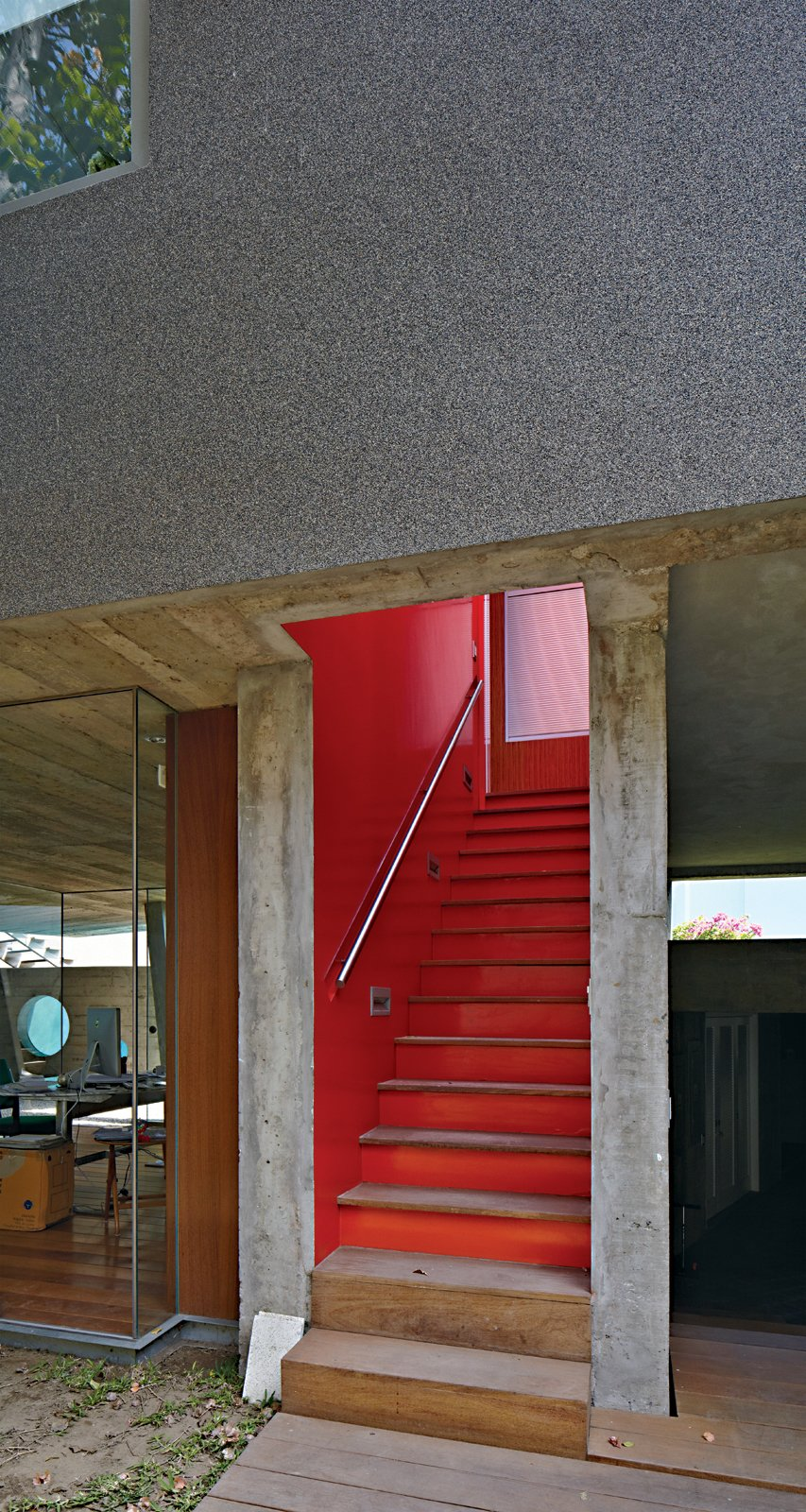 Staircase, Wood Tread, and Metal Railing Given Lima's dry climate, the architects were able to introduce clever indoor-outdoor gestures such as an open stairwell, and semicovered walkways that allow the trees to provide cover.  Photo 13 of 13 in A Modern Concrete Home in Peru