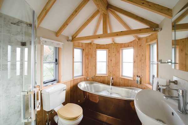 Custom designs, however, are the opposite of roughing it. Pictured, an interior of the Fox and Hounds countryside hotel in Devon, a project built around a 250-year-old oak that includes a tower and turrets.