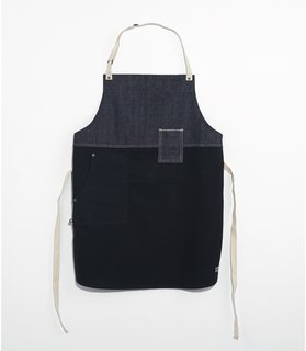 Chambray and wax cotton chef's apron, $80, from Tilit.   Made in New York, Tilit's aprons are wax coated and hardier than most, resisting all manner of cooking messes.