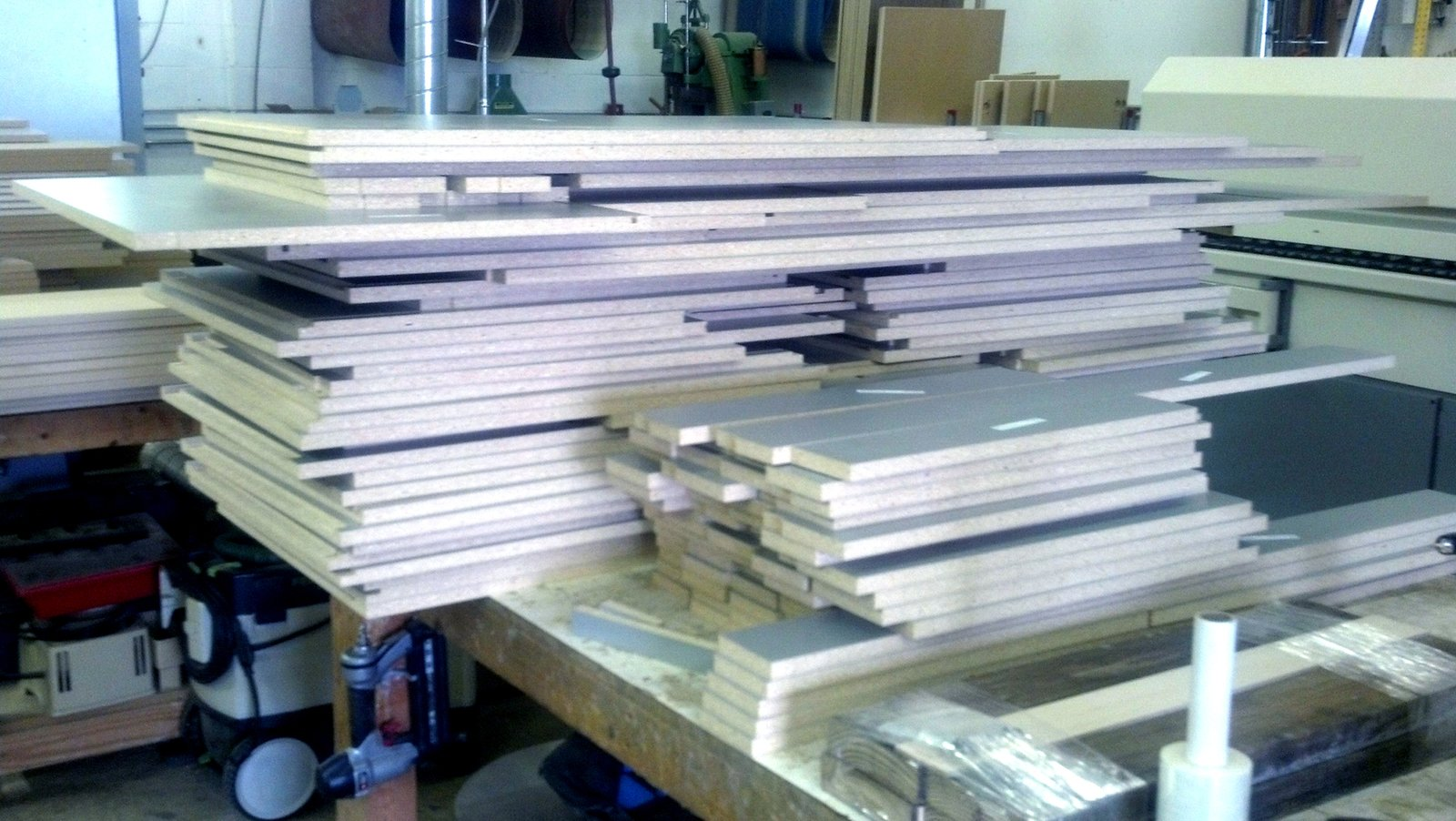 Cabinet components are stacked up ready to be joined into boxes or delivered as panels for interior cabinet shelving.  Photo 5 of 17 in Dwell Home Venice: Part 18