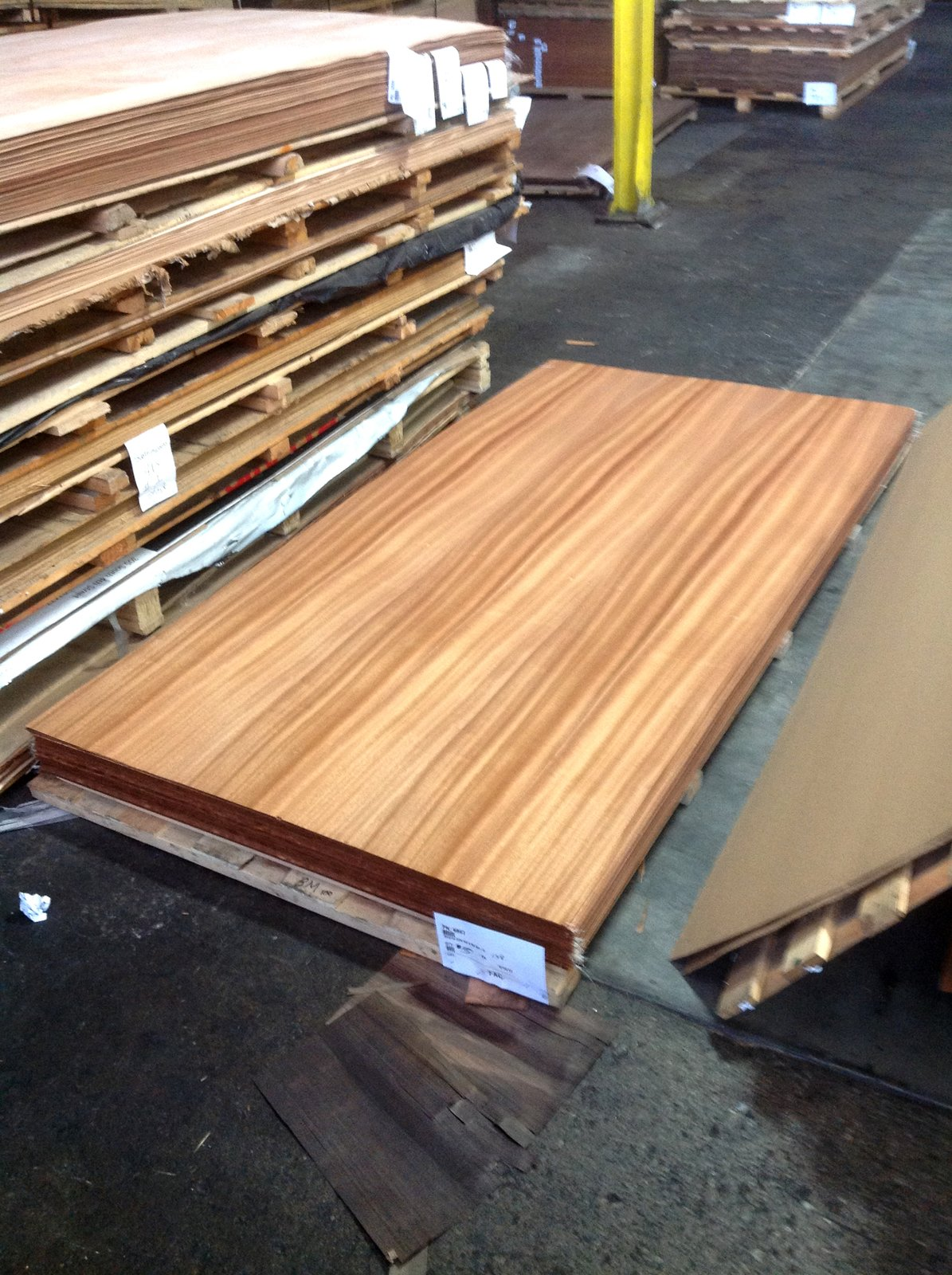 Selecting the mahogany veneers to be used on all cabinet doors, exterior panels and various trim.  Photo 6 of 17 in Dwell Home Venice: Part 18