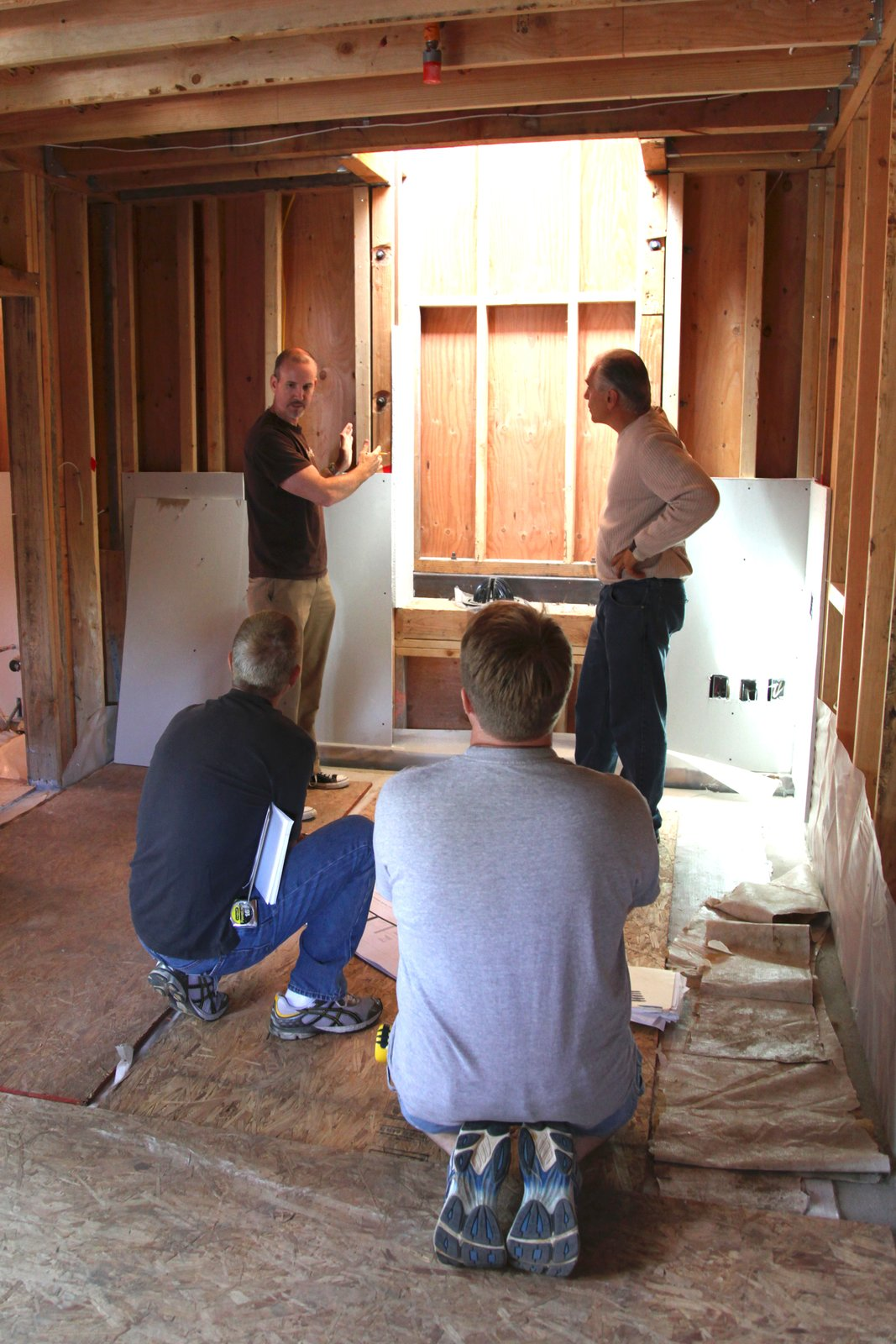 Planning a cabinet installation. The drywall panels are in place temporarily to simulate cabinet panels or to check dimensions between finished walls.  Photo 8 of 17 in Dwell Home Venice: Part 18
