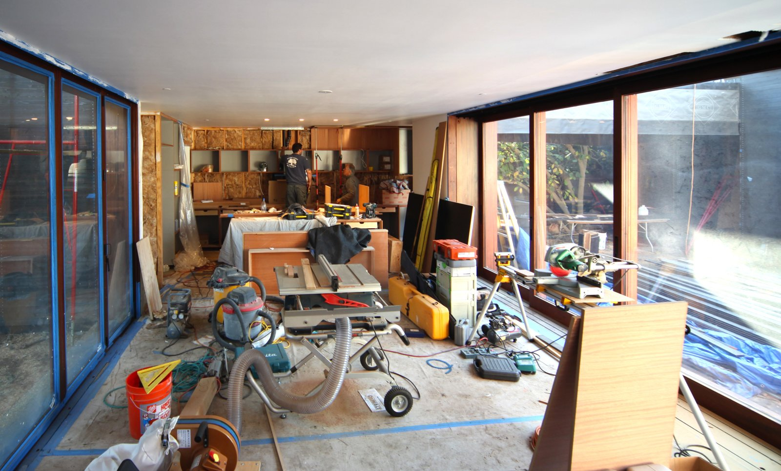 The great room is converted into a temporary wood shop as the kitchen and other cabinets are installed.  Photo 11 of 17 in Dwell Home Venice: Part 18