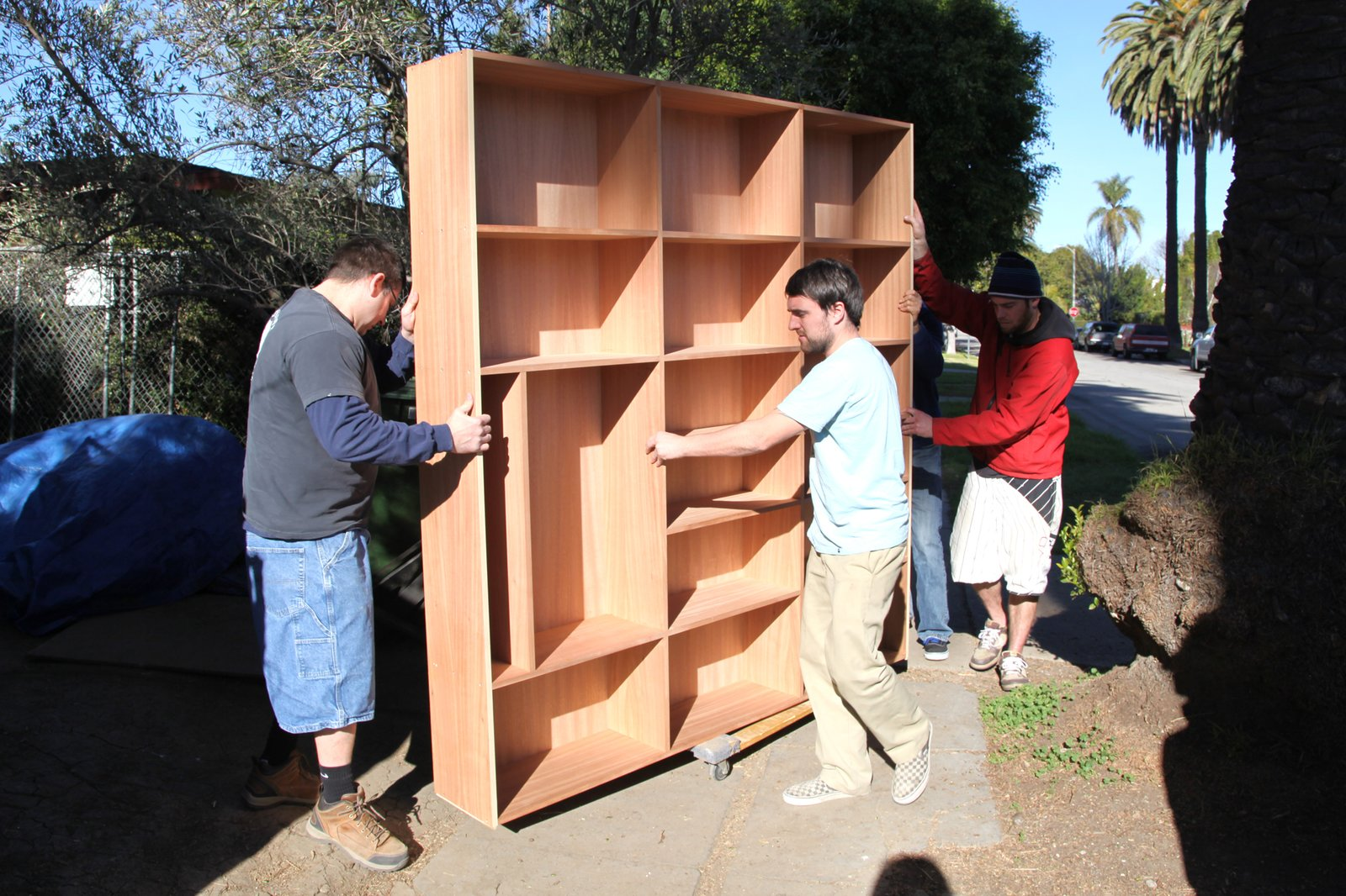 The Semihandmade team delivers the living room bookshelf.  Photo 12 of 17 in Dwell Home Venice: Part 18