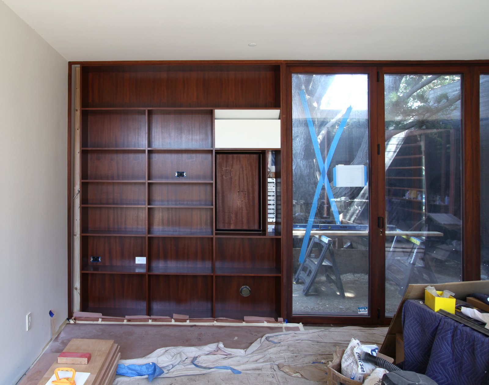 There is an art to matching the mahogany stain on the cabinets with the large doors that were provided by a different vendor. The image shows a good color match.  Photo 16 of 17 in Dwell Home Venice: Part 18