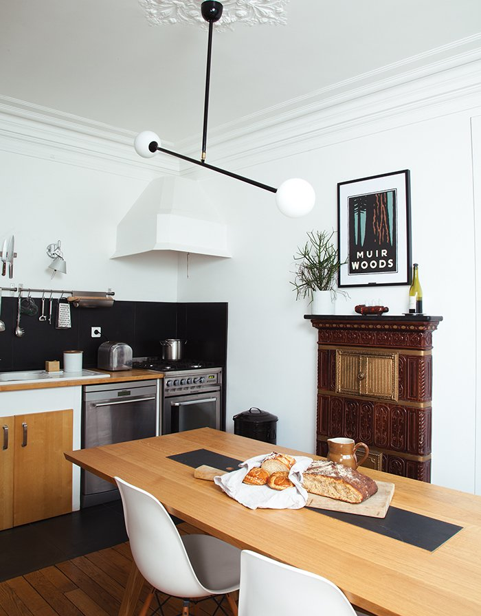 Kitchen, Range, and Dishwasher A Two Spheres ceiling lamp from Atelier Areti hangs above the Hansen's dining table, which includes an inset—one side is wood, the other stone.  Photo 3 of 14 in Modern Furniture Designer Continues Her Family Tradition
