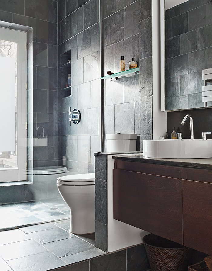"""Bath, Slate, Vessel, Enclosed, Wood, Stone Slab, and One Piece In the master bath, on the third floor, Greenguard-certified slate covers the walls and floor. An existing window was transitioned into a doorway. """"I thought that'd be weird, a door in the shower,"""" David recalls. """"But Alysia said it would make that particular terrace all the more private if we have to get to it through our shower!""""  Best Bath One Piece Vessel Enclosed Photos from Sustainability Guided Every Decision at this Town House Remodel in Harlem"""